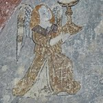 Remains of an early painting of an angel in the Abbey of Saint Hilaire