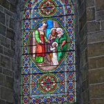 Stained glass window in the Abbey Church in Saint Hilaire