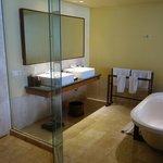 Bathroom has a beautiful big bath and shower