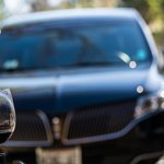 Lincoln MKT behind a glass of Cab