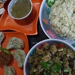 Momos. Traditional Pork Salad with Sticky Rice