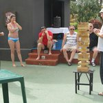 Ola (in pink top) overseeing a game of Jenga
