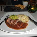 Duck breast, cabbage, potatoes and red wine sauce