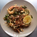 Exmouth prawns w/ native salsa verde, warrigal spinach, roast almond & lemon