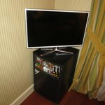 TV with minibar cleverly used as table