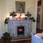 Fireplace in main dining room, decked out for the holidays.