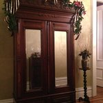 An armoire in the first floor foyer.