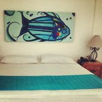 Original paintings  by local artists become notes of color inside our rooms and Suites