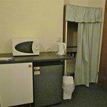 Microwave/jug/fridge adjacent to the front door.