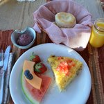 Cheese frattata, fresh fruit, homemade biscuit with blueberry butter.  So good!