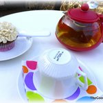 Mandarin Green tea and cupcake on the patio