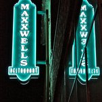 The Maxxwells sign at night