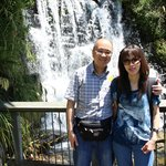 With my wife at the small waterfalls near the exit gate