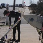 Kids getting there boards ready to surf prior to board walk being repaired after Super Storm San