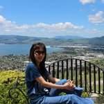 My wife enjoying the beautiful day at Aorangi Peak