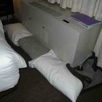 Pillows used to block draught and noise