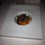 third course, pig belly, on a hot plate