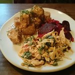 Satay tofu stacks with kale, tomatoe and black olive coleslaw and also madras roasted betroot