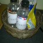 A basket in the room with things for sale. You pay even for water.