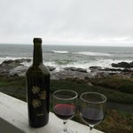Sipping wine, watching the waves roll in.