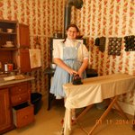Dorothy ironing in the kitchen