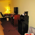 Room with desk, tv, fridge, microwave, coffemaker