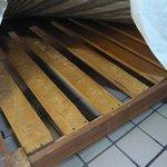 Thick, hard wooden slats under equally hard mattress!