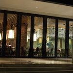 Restaurant seen from courtyard at night