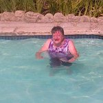 My 70 year old mum with a smile from ear to ear after her first dip in a pool in years ;)