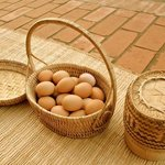 Some boiled eggs, sticky rice, with mat (prepare for the monks)