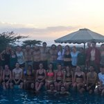 Our massive group by the pool on our first day at the lodge as the sun goes down over the reserv