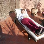 Elizabeth enjoying the sun on the roof terrace