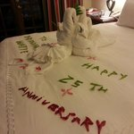 our bed was decorated with flower and a special message