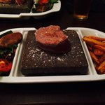 Rump steak on hot lava rock.