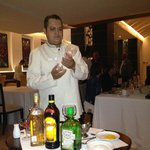 Waiter making specialty drink tableside