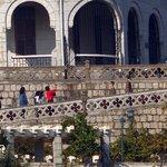 Visitors walking up Penha Church
