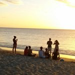 A group awaiting for the sunset at Combate Beach