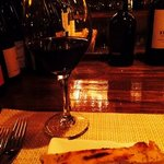 A glass of cabernet and warm rosemary foccacia at the bar