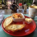 Delicious breakfast! Spanish revoltillo (scrambled eggs, tomato, onion) with homemade bread.