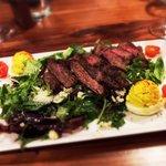 STEAKHOUSE SALAD Broiled Prime Sliced Steak, Deviled Egg, Crunchy Cress, Avocado, Bacon, Parmes