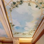 The fresco above the bed.