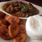 goat stew with plantains and mashed corn