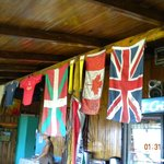 Many different flags hang with signatures from past guests.