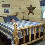 The Cabin has a log bed custom made by a local craftsman