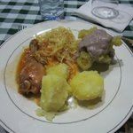 A more traditional dinner of Irish potatoes, cabbage, chicken, and matoke with peanut sauce.