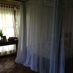Room with mosquito nets down