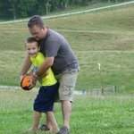 Lukah and Simon playing rugby