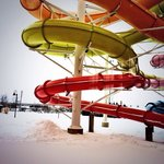 Water slides go outside & you can feel the crisp air in winter
