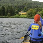 Canoeing past an estate