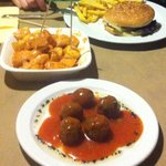 Bull burger, spicy potatoes Bravia and meatballs yummy